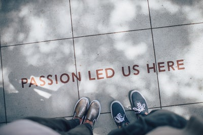 Passion Led Us Here on Sidewalk